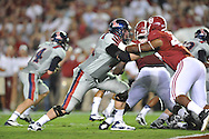 Ole Miss offensive lineman Pierce Burton (71) blocks Alabama defensive lineman Ed Stinson (49) at Bryant-Denny Stadium in Tuscaloosa, Ala. on Saturday, September 29, 2012.