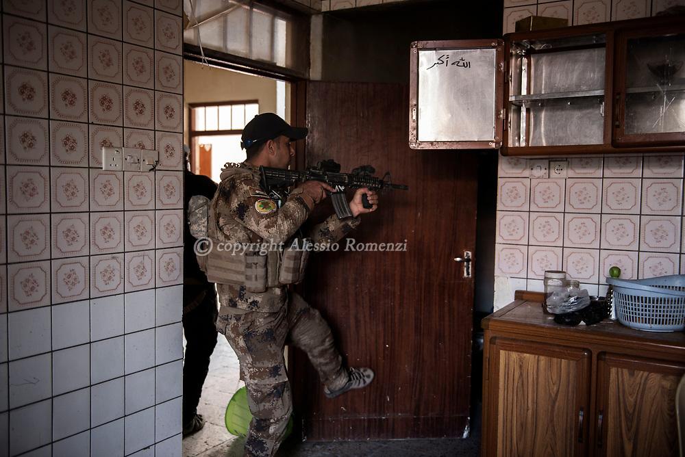 Iraq, Mosul: Iraqi soldiers search for ISIS fighters in west Mosul. Alessio Romenzi