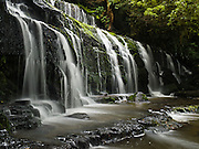 """Purakaunui Falls, in the Catlins District, South Island, New Zealand. Published in """"Light Travel: Photography on the Go"""" by Tom Dempsey 2009, 2010."""