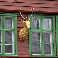 Europe, Norway, Bergen. Bryggen facade deer, a UNESCO World Heritage Site.