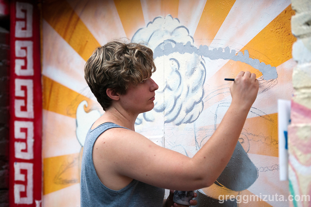 Julie Pegan works on her mural in the evening of August 8, 2016 during the Freak Alley Gallery sixth annual mural event in downtown Boise, Idaho.<br /> <br /> The week long event provided an &quot;art-in-motion&quot; experience as it welcomed the public to watch artists work on their murals.