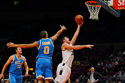 Nov 21, 2008; New York, NY, USA; Southern Illinois Salukis forward Tony Boyle (35) scores a basket past UCLA Bruins forward Drew Gordon (0) during first half action of the 2K Sports Classic consolation game at Madison Square Garden.