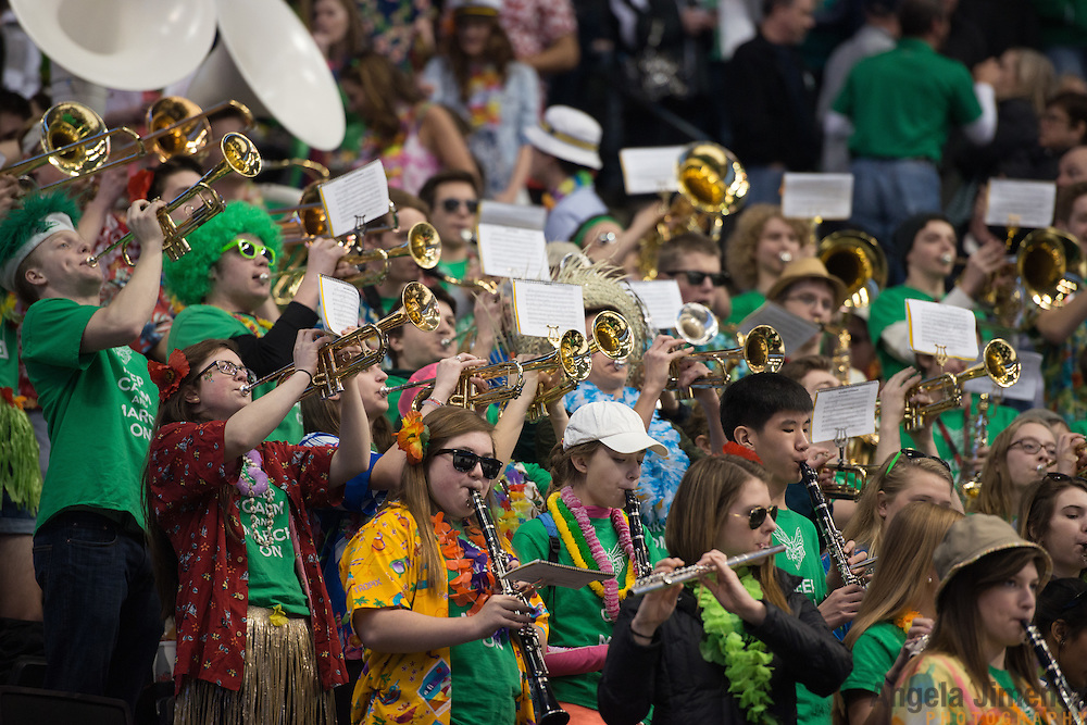 The Edina marching band plays during the Class AA semifinal game between Duluth East and Edina (Duluth East won 3-1)at the Minnesota State High School League Boys' State Hockey Tournament at the Xcel Energy Center in St. Paul, Minnesota on March 6, 2015. <br />  <br /> <br /> Photo by Angela Jimenez for Minnesota Public Radio www.angelajimenezphotography.com