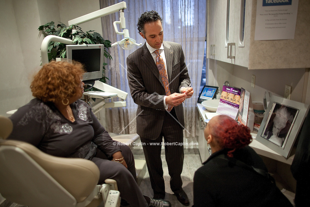 Dr. Scott Blyer gives an HGC diet consultation to patients in his New York City offices. ..Photo by Robert Caplin.