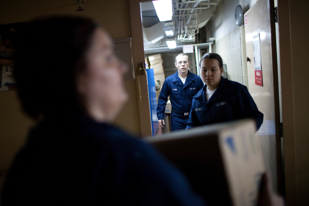 Navy medical personnel pack away supplies on board the USNS Comfort, a naval hospital ship, as it makes its way to Haiti to help earthquake survivors on Saturday, January 16, 2010 in the Chesapeake Bay.