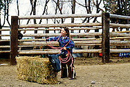 Young cowgirl gets tangled up practicing roping, Montana, <br /> MODEL RELEASED