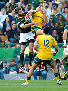 CAPE TOWN, SOUTH AFRICA - Saturday 28 September 2013, Willie le Roux of South Africa and Quade Cooper of Australia tussle for the ball during the Castle Lager Rugby Championship test match between South Africa (Sprinkboks) and Australia (Wallabies) at DHL Newlands in Cape Town.<br /> Photo by Roger Sedres/ ImageSA