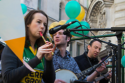 London, March 13th 2016. The annual St Patrick's Day Parade takes place in the Capital with various groups from the Irish community as well as contingents from other ethnicities taking part in a procession from Green Park to Trafalgar Square.  PICTURED: An Irish folk band play on the back of one of the floats. &copy;Paul Davey<br /> FOR LICENCING CONTACT: Paul Davey +44 (0) 7966 016 296 paul@pauldaveycreative.co.uk
