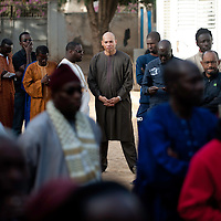 Abdoulaye Wade's son Karim Wade waits in the queue for voting in the presidential elections at a polling station in a Franco-Arab School in Point E area of Dakar..Hundreds of people, queueing for voting since the early hours, insulted and heckled the president and candidate Abdoulaye Wade during his vote casting at the poll station, accusing the head of state of disrespect for the country's constitution when running for a third term in office..Tensions between opposition supporters and security forces have been high in the capital Dakar and other cities around the country since Wade announce his candidature late July. Some violent clashes culminated with the death of 12 people and many injured in the past month alone. ©Sylvain Cherkaoui