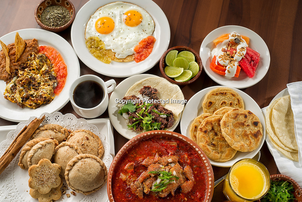 Table spread with assorted tipical Mexican breakfast.
