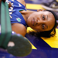 INDIANAPOLIS, IN - OCTOBER 21: Candice Wiggins #11 of the Minnesota Lynx stretches before playing against the Indiana Fever in Game Four of the 2012 WNBA Finals on October 21, 2012 at Bankers Life Fieldhouse in Indianapolis, Indiana. NOTE TO USER: User expressly acknowledges and agrees that, by downloading and or using this Photograph, user is consenting to the terms and conditions of the Getty Images License Agreement. (Photo by Michael Hickey/Getty Images) *** Local Caption *** Candice Wiggins