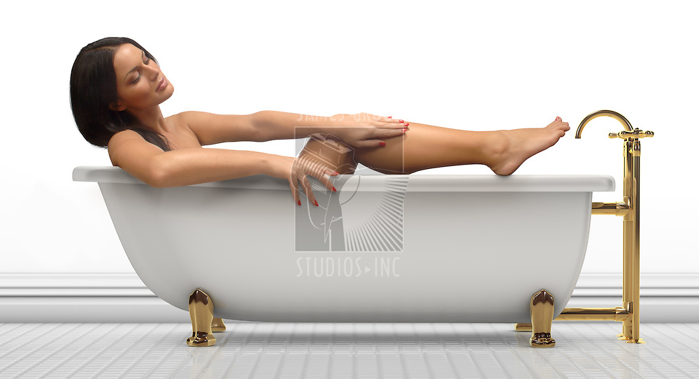 Young woman in an antique bathtub on a white background
