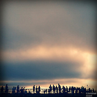 A crowd of people gathered at the Venice Beach Skate Park
