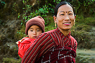 Nepali Woman and her Child - The population of Nepal is a mosaic of diverse ethnic groups including the Thakali, Tamang, Newar, Sherpa, Tibetan and Gurung.  This is a meeting place of Indo-Aryan peoples from the Indian subcontinent as well as the Mongoloid people of the Himalaya regions.