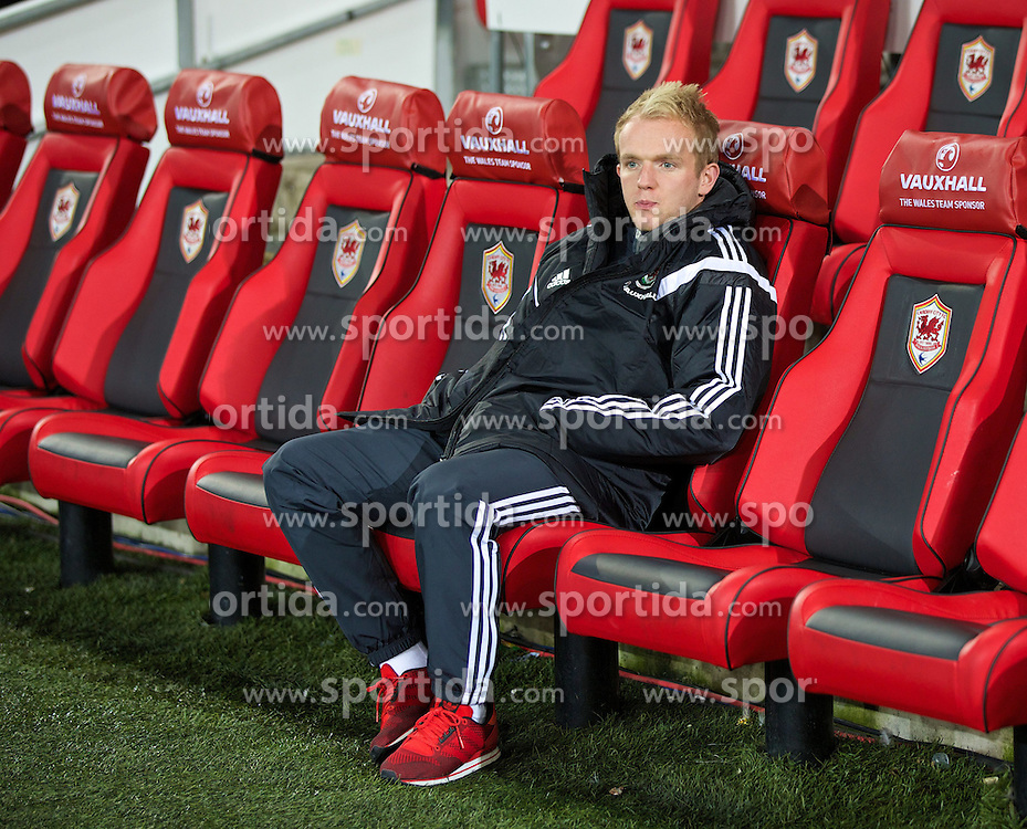 13.10.2014, City Stadium, Cardiff, WAL, UEFA Euro Qualifikation, Wales vs Zypern, Gruppe B, im Bild Wales' injured Jonathan Williams sits on the bench // 15054000 during the UEFA EURO 2016 Qualifier group B match between Wales and Cyprus at the City Stadium in Cardiff, Wales on 2014/10/13. EXPA Pictures &copy; 2014, PhotoCredit: EXPA/ Propagandaphoto/ David Rawcliffe<br /> <br /> *****ATTENTION - OUT of ENG, GBR*****