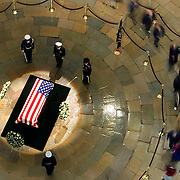 Washington, Dec. 31, 2006 - Visitors make their way through the Rotunda of the Capitol to pay their respects to the late President Gerald R. Ford as he lays in state on Sunday, Dec. 31, 2006 in Washington.