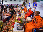 "14 FEBRUARY 2017 - BANGKOK, THAILAND: Buddhist monks bless marriages during a mass wedding in the Bang Rak district in Bangkok. Bang Rak is a popular neighborhood for weddings in Bangkok because it translates as ""Village of Love."" (Bang translates as village, Rak translates as love.) Hundreds of couples get married in the district on Valentine's Day, which, despite its Catholic origins, is widely celebrated in Thailand.     PHOTO BY JACK KURTZ"