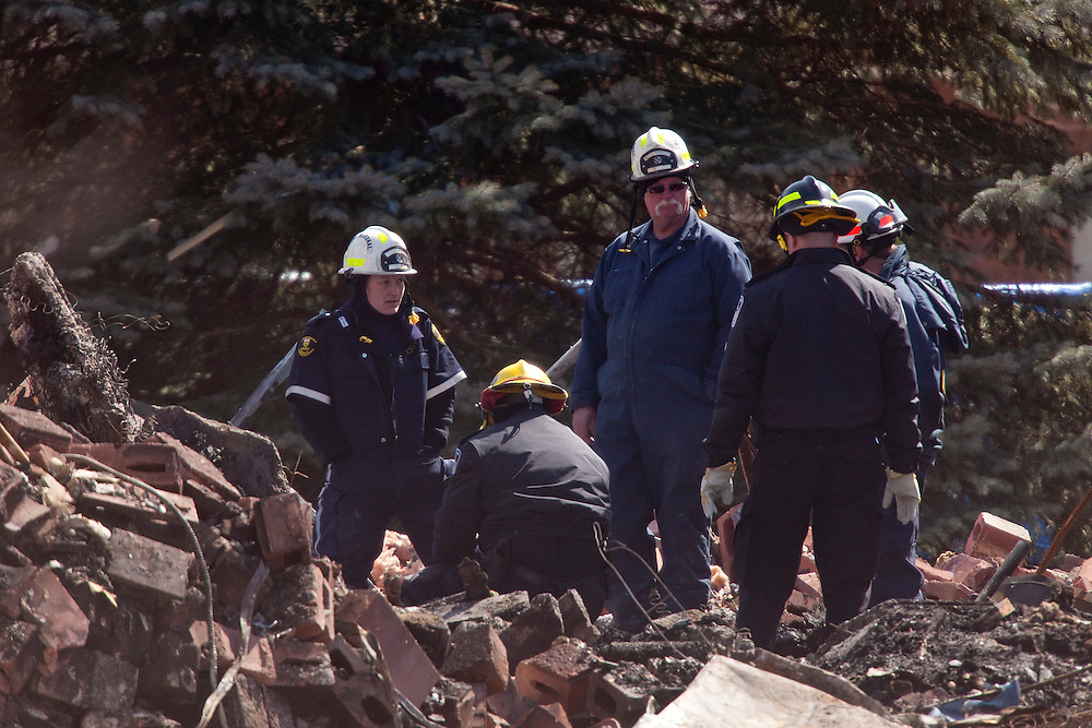 Investigators from the Ontario Fire Marshal's office and the Police examine remains found in the rubble of an apartment building in Woodstock Ontario, Wednesday, March 30, 2011. The building exploded Sunday morning leaving 2 residents missing and presumed dead.<br /> THE CANADIAN PRESS/ Geoff Robins