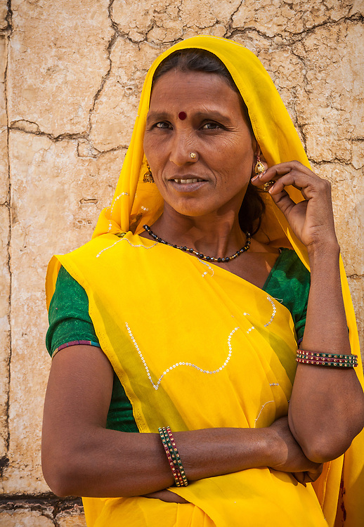 An Indian woman posing for photographs in Amer Palace, Amer, Rajasthan, India.