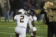 Mary Hardin-Baylor players and fans comfort each other after the last-second loss to Mount Union in the semifinal game.