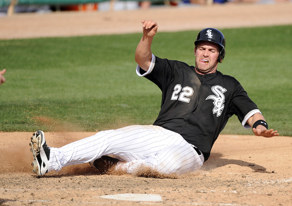 GLENDALE, AZ - MARCH 03:  Matt Davidson #22 of the Chicago White Sox slides home safely against the Kansas City Royals on March 3, 2014 at The Ballpark at Camelback Ranch in Glendale, Arizona. (Photo by Ron Vesely)   Subject: Matt Davidson
