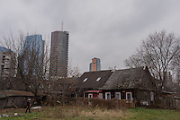 Snipiskes, a region of Vilnius, is known for it's modern skyscrapers as well as its traditional wooden homes.