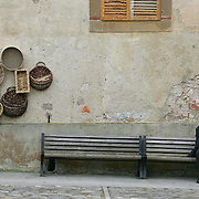 SHOT 3/2/2006 - An old Italian man sits on a bench in a small town in Tuscany one afternoon smoking a cigarette and passing time. Tuscany (Italian: Toscana) is one of the twenty Regions of Italy. The capital is Florence, and it has an area of 22,990 km? and about 3.6 million inhabitants. Tuscany is known for its landscapes and its artistic legacy. Tuscany is a region of Central Italy, bordering Emilia-Romagna to the north, Liguria to the north-west, Tyrrhenian Sea to the west, Umbria and Marche to the east, Lazio to the south-east. The territory is two thirds hilly and one fourth mountainous. The remainder is constituted of the plains that form the valley of the Arno River..(Photo by MARC PISCOTTY/ © 2006)
