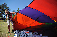 "Leah Bridge helps fill a hot air balloon during St. Peter's Episcopal Church's ""Fun in the Country"" in Oxford, Miss. on Monday, September 6, 2010."