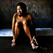 """Bali, Indonesia. Mental diseases in paradise. The Balinese community doesn't accept the existance of this illness. Famillies and people are not well informed and ready to face the disease. Ketut, 32 years old. Schizophrenic for 5 years, in """"prison"""" since 4. He lives naked, he doesn't want clothes, he rips them off as soon as his father tried to put them on him"""