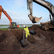 Location photography of the installation of a dranage system on the Somerset Levels