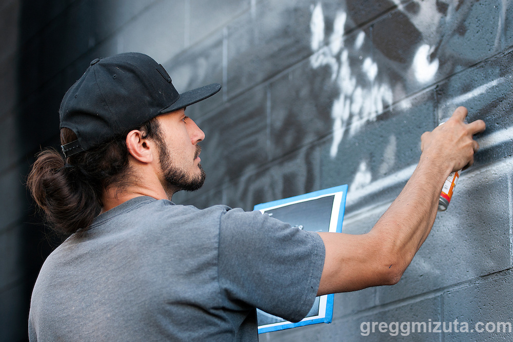 Sector Seventeen artist Solomon Hawk Sahlein &quot;Elms One&quot; paints a mural based on a J. Grant Brittain image of Neil Blender. Elms painted the mural during the Mics and Mini Ramps event on June 25, 2016 at The Shredder in Boise, Idaho. (Gregg Mizuta/greggmizuta.com)<br /> <br /> Performances by Edable &amp; Elms One, Axiom Tha Wyze &amp; Andy O, Tony G, and Auzomatik. Food by Wetos Locos, and live painting by Elms One.