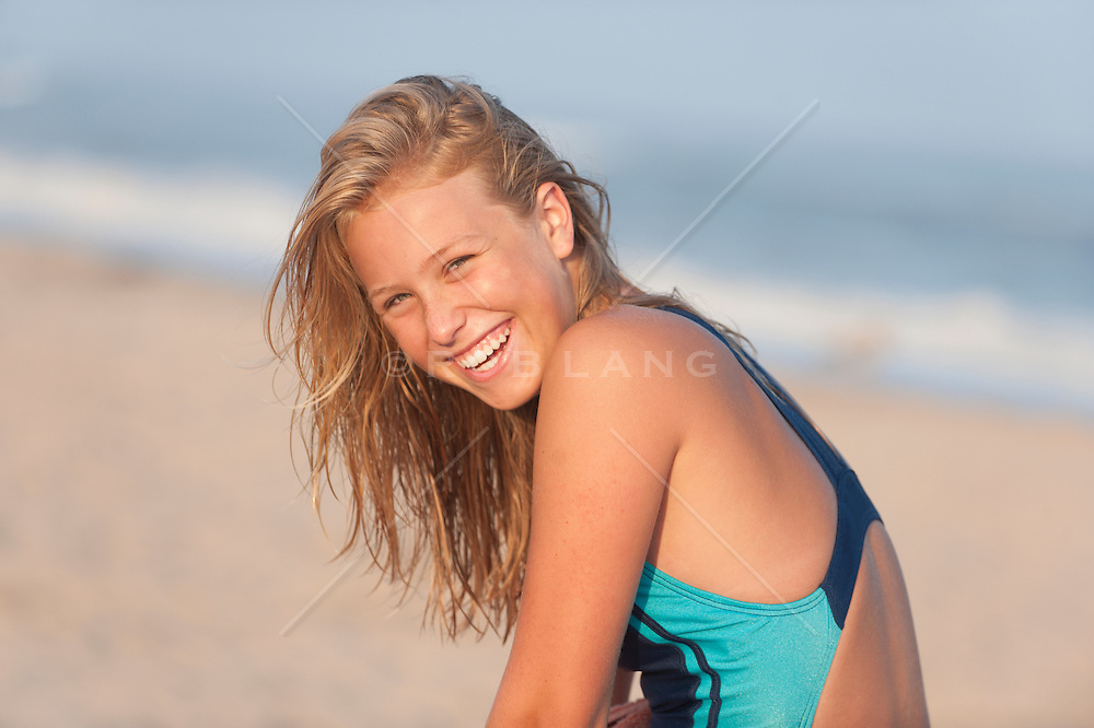 teenage girl with wet hair at the  beach in East Hampton, NY