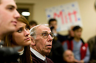 A member of the audience listens as former Massachusetts governor Mitt Romney campaigns in Manchester, N.H., on Friday, Jan. 4, 2008.