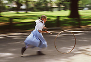 "Recess at the Pioneer School in Elk Grove, CA means a game of ""stick and hoop"" for a student.  All the elementary school students spend a week studying the history of the early settlers to the area,"