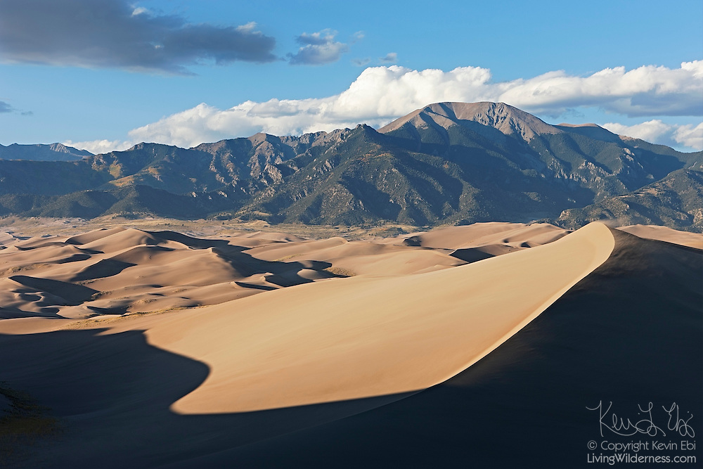 Great Sand Dunes National Park is home to the tallest sand dunes in North America. The tallest of the dunes climb 750 feet from the San Luis Valley. The valley is very windy and the sands are trapped by the Sangre de Christo Mountains, visible in the background.