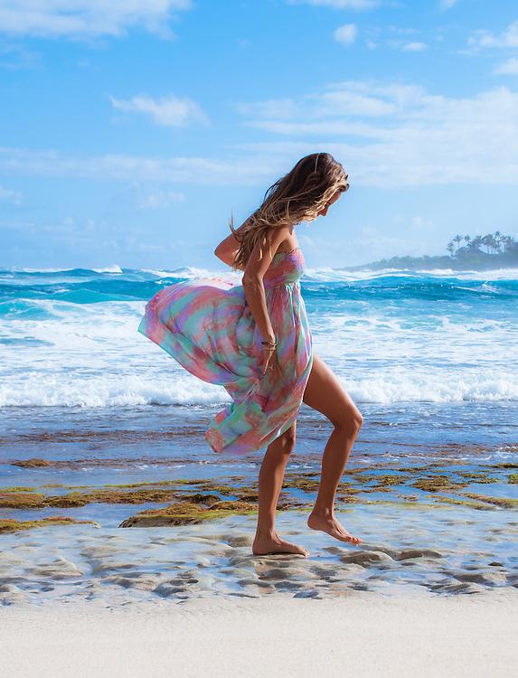 Woman on the beach in Hawaii wearing Tiare Hawaii Over the Rainbow Dress <br /> www.tiarehawaii.com<br /> Model Andrea Hannemann