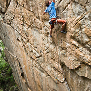 "Ben Rueck reaches for a sloper on the amazing 5.13 ""Red Faction."" Redstone, CO."