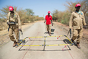 Pictured is an UNMAS team conducting route assessment clearance on the Pariang-Panakuach Road north of Bentiu, using a large loop metal detector.<br /> <br /> Photo: UNMAS/ Martine Perret