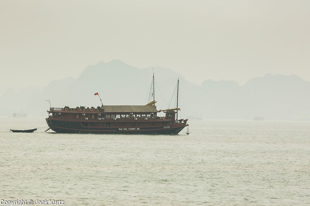 03 APRIL 2012 - HA LONG, VIETNAM:  Tourists cruise ships leave Ha Long Harbor for Ha Long Bay, Vietnam. In 1994 UNESCO declared 174 square miles of Ha Long Bay a World Heritage Site. There are nearly 2000 distinct rock islands in the bay, which for centuries has been the home to isolated fishing villages. Now thousands of tourists stream through the bay and around the islands every day on cruise ships. On the Vietnamese mainland, around the town of Ha Long, real estate companies are developing exclusive condominium and apartment complexes for use as weekend homes for people in Hanoi, about a 3.5 hour drive from Ha Long.    PHOTO BY JACK KURTZ