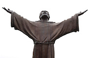 A statue of St. Francis of Assisi, raising his hands heavenward. The statue is located at St. Lawrence High School Seminary in Mount Calvary. (Photo by Sam Lucero)