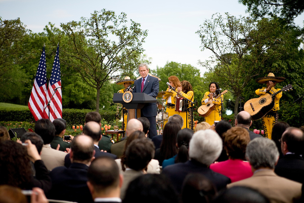 President Bush makes a speech at a Cinco de Mayo celebration in the Rose Garden at the White House in Washington, DC, on Friday, May 4, 2007. A mariachi band called Los Hermanos Mora Arriaga performed at the event.