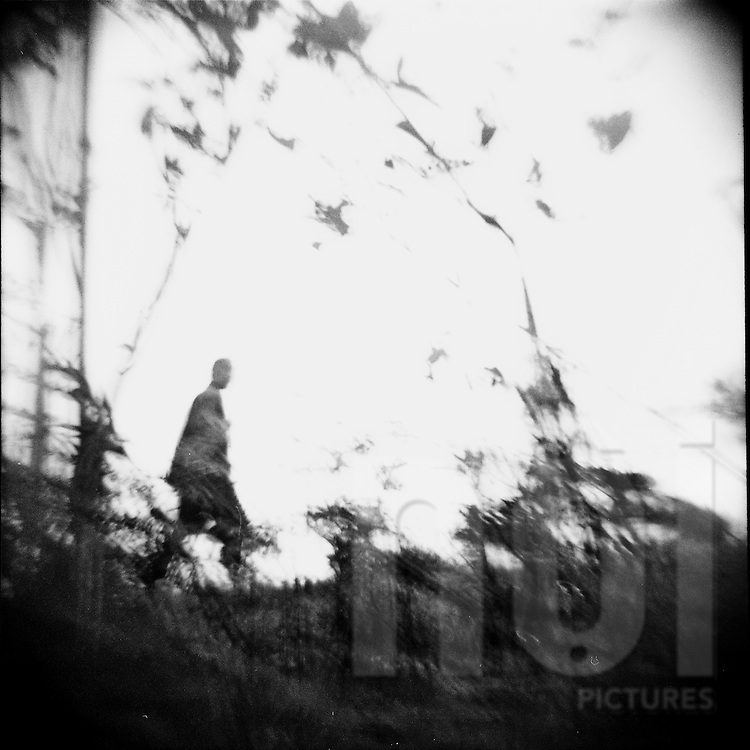 Mysterious blurry silhouette walking in the bush, Ha Giang Province, Vietnam, Southeast Asia