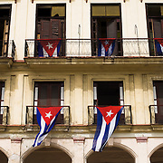 Cuban flags hang from balconies of a building in central Havana, Cuba on Friday June 27, 2008.