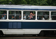 A North Korean girl looks out from the window of an electrically powered bus in Pyongyang, North Korea Tuesday Aug. 7, 2007.