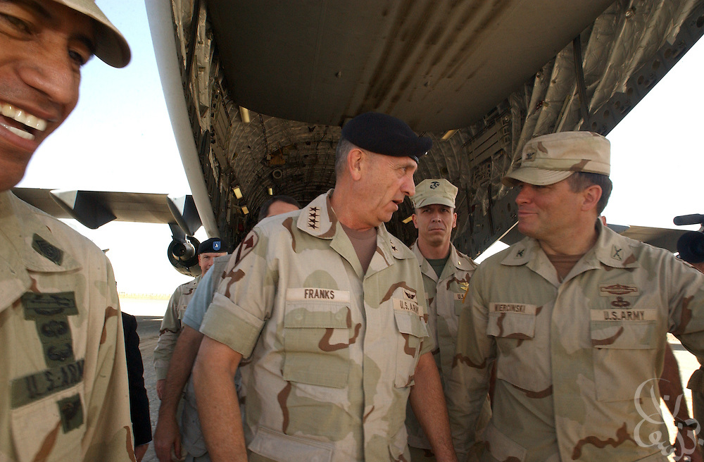 U.S. Commander of Central Command, Gen. Tommy Franks (c) is greeted by Colonel Frank Wiercinski (r), commander of the 3rd Brigade 101st Airborne May 15, 2002 at Kandahar airbase in southern Afghanistan. Franks stopped at the base to personally address the troops deployed there as part of Operation Enduring Freedom.