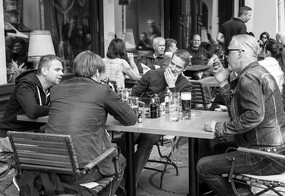 Delightful conversation with friends mixed witha glass of beer. Local  scene at a  Prague cafe.