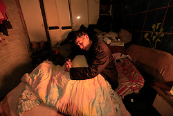 Chinese villager Xie Xianwen of Xiangnan Village who was diagnosed with lung cancer in the terminal stages rests in his bed at home in Zekou Town, Qianjiang City of Hubei Province, China 15 January 2013. Xie's wife believes his cancer was caused by the pollution from the chemical plant nearby and now he could not even rest properly as constant noise pollution from the factories deprived him of sleep. While the heavy smog in Beijing and much of northern China in recent days have caused alarm among residents and renewed scrutiny on the pollution woes of the country, villagers in a small town of Hubei Province have been grappling with severe air, water and noise pollution on a daily basis over the past two years. China's Xinhua news reported 04 January 2013 that more than 60 cancer deaths in various villages of Zekou Town has been caused by the heavy pollution from the chemical industry park nearby. About 20 or more chemical plants built around the villages of Dongtan, Xiangnan, Zhoutan, Sunguai, Qingnian and others over the past two years has created huge increases in noise, air and water pollution. Many villagers complained of intensifying respiratory, heart, skin and circulatory illnesses caused by the pollution and a large spike in cancer diagnoses and deaths since the factories were built. .