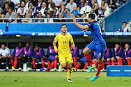 SAINT-DENIS, FRANCE, 10.06.2016 - FRANCE-ROMANIA - Adil Rami (D) of France, dispute the ball with Florin Andone of Romania, in a match valid for the 1st round of Group A of Euro 2016 in the Stade de France in Saint-Denis, on Friday (10).
