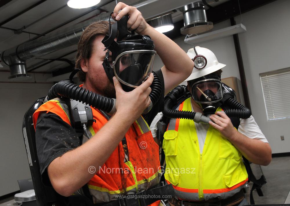 Mining engineering student, Myra Dobar, suits up in rescue equipment during training at the San Xavier Mining Laboratory Training Center, University of Arizona, Tucson, USA.