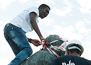 CAPE TOWN, SOUTH AFRICA - Thursday 9 April 2015, a student ties the head of he statue in tape during the removal of the statue of CECIL JOHN RHODES at the University of Cape Town. Rhodes (5 July 1853 &ndash; 26 March 1902) was a British businessman, mining magnate, and politician in South Africa. An ardent believer in British colonialism, Rhodes was the founder of the southern African territory of Rhodesia, which was named after him in 1895. South Africa's Rhodes University is also named after Rhodes. He set up the provisions of the Rhodes Scholarship, which is funded by his estate. <br /> Photo by Roger Sedres/ ImageSA